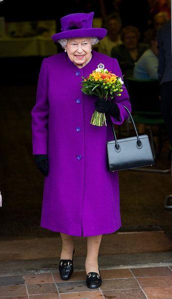 Purple, Fashion, Street fashion, Coat, Event, Headgear, Outerwear, Hat, Fashion design, Formal wear,