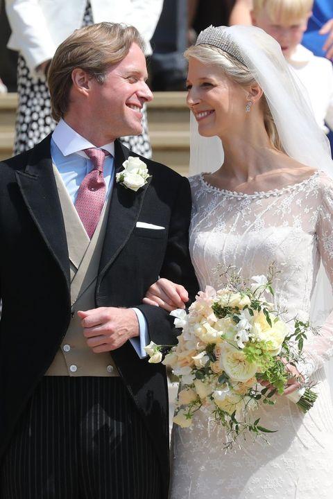 Clothing, Coat, Petal, Bridal veil, Bouquet, Bridal clothing, Photograph, Suit, Outerwear, Dress,