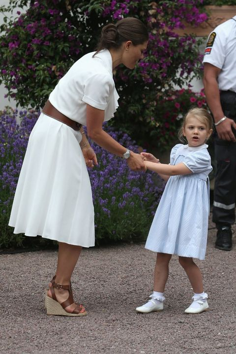Child, Pink, Footwear, Interaction, Gesture, Holding hands, Flower, Event, Plant, Toddler,