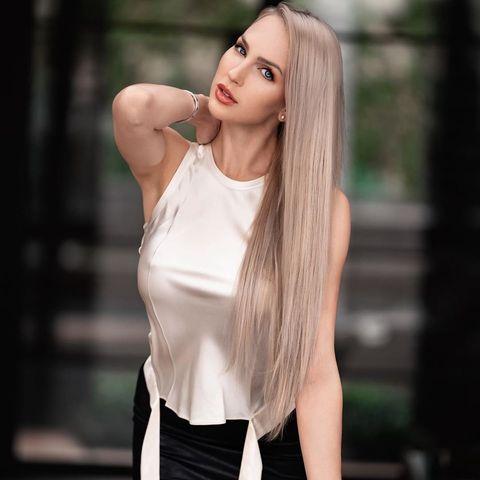Hair, White, Face, Blond, Beauty, Long hair, Hairstyle, Clothing, Skin, Head,