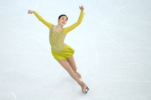 Figure skate, Figure skating, Ice skating, Jumping, Ice dancing, Skating, Dancer, Recreation, Yellow, Sports,