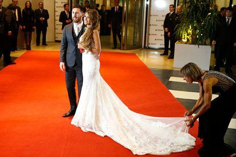 Red carpet, Gown, Dress, Carpet, Bride, Wedding dress, Photograph, Bridal clothing, Flooring, Ceremony,