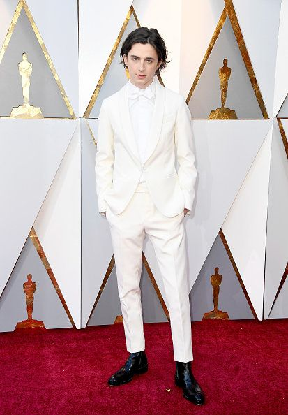 White, Red carpet, Carpet, Clothing, Fashion, Suit, Flooring, Outerwear, Formal wear, Haute couture,