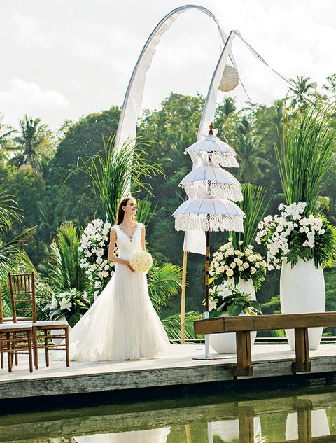 Photograph, White, Wedding dress, Dress, Bride, Bridal clothing, Gown, Bridal accessory, Ceremony, Architecture,