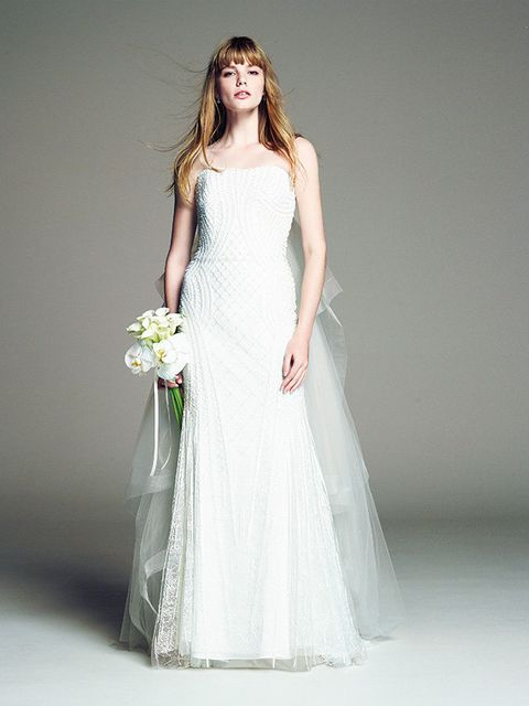 Dress, Sleeve, Bridal clothing, Shoulder, Textile, Photograph, Joint, Standing, Gown, Formal wear,