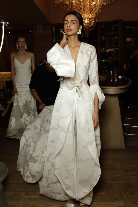 Fashion model, Clothing, Dress, White, Gown, Fashion, Haute couture, Fashion design, Shoulder, Formal wear,