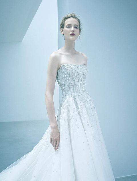 Gown, Wedding dress, Clothing, Dress, Fashion model, Bridal party dress, Bridal clothing, Shoulder, Photograph, Bridal accessory,