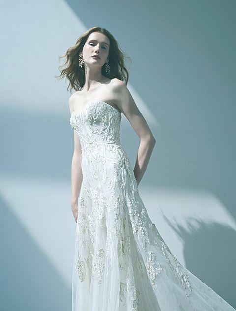 Gown, Wedding dress, Fashion model, Clothing, Dress, Shoulder, Bridal party dress, Bridal clothing, Photograph, Waist,