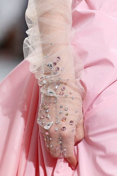 Pink, Dress, Hand, Bridal accessory, Haute couture, Textile, Fashion accessory, Peach, Glove, Formal gloves,