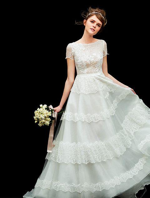 Gown, Wedding dress, Clothing, Dress, Fashion model, Bridal clothing, Bridal party dress, Shoulder, Bride, Bridal accessory,