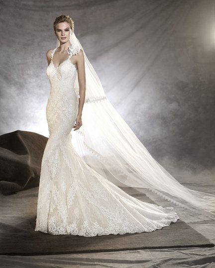 Gown, Wedding dress, Fashion model, Dress, Clothing, Bridal clothing, Bridal party dress, Bride, Shoulder, Bridal accessory,