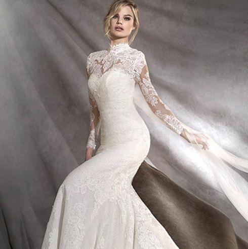 Gown, Wedding dress, Dress, Clothing, Fashion model, Bridal clothing, Shoulder, Bridal party dress, Bridal accessory, A-line,