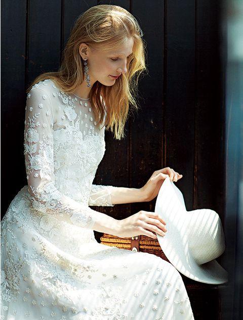 Clothing, Dress, Beauty, Gown, Fashion, Wedding dress, Sitting, Shoulder, Blond, Photo shoot,