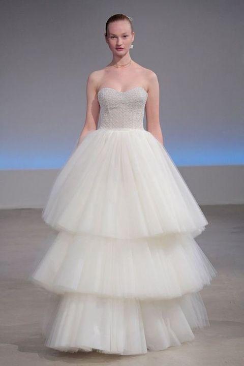 Gown, Wedding dress, Clothing, Fashion model, Dress, Bridal clothing, Bridal party dress, Photograph, Shoulder, Haute couture,