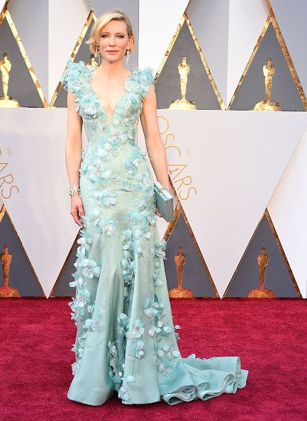 Carpet, Red carpet, Clothing, Dress, Flooring, Gown, Fashion, Formal wear, Haute couture, Fashion model,