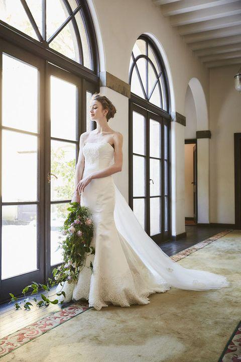 Wedding dress, Gown, Bride, Dress, Clothing, Photograph, Bridal clothing, White, Bridal party dress, Bridal accessory,