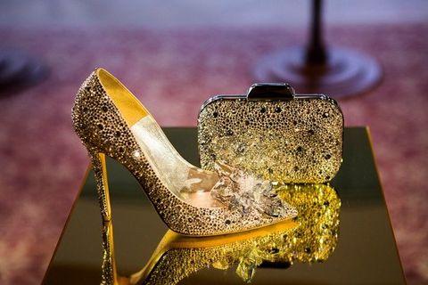 High heels, Footwear, Yellow, Shoe, Dress shoe, Gold, Fashion accessory, Metal, Still life photography, Dress,