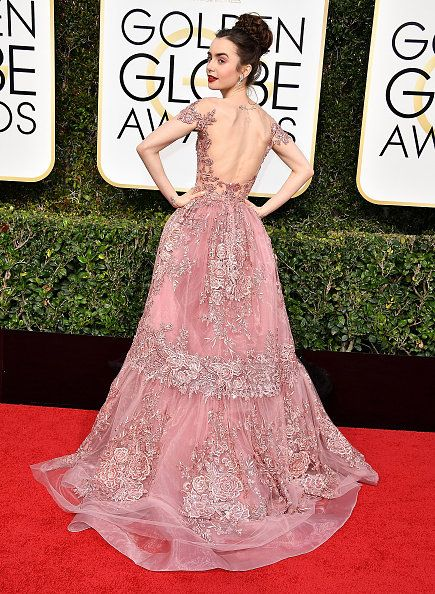 Dress, Red carpet, Gown, Carpet, Clothing, Flooring, Pink, Strapless dress, Shoulder, Fashion model,
