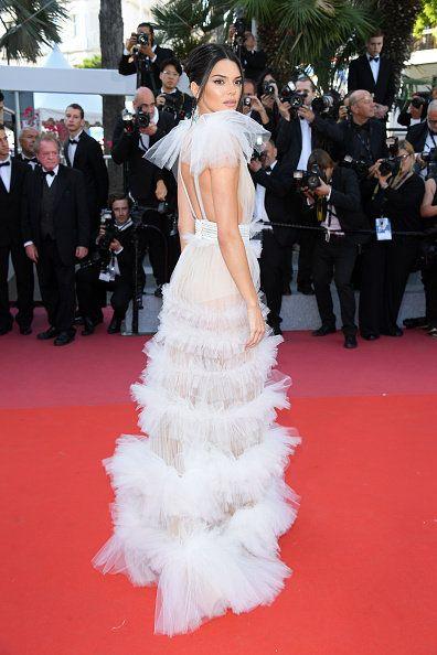 Gown, Red carpet, Dress, Carpet, Flooring, Clothing, Premiere, Shoulder, Fashion, Haute couture,