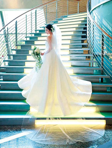 Wedding dress, Dress, Photograph, Bride, Aqua, Bridal clothing, Blue, Gown, Stairs, Yellow,