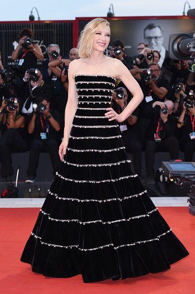 Fashion model, Dress, Clothing, Red carpet, Gown, Carpet, Fashion, Flooring, Premiere, Strapless dress,