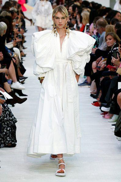 Fashion, Fashion model, Runway, Fashion show, White, Clothing, Haute couture, Shoulder, Event, Dress,