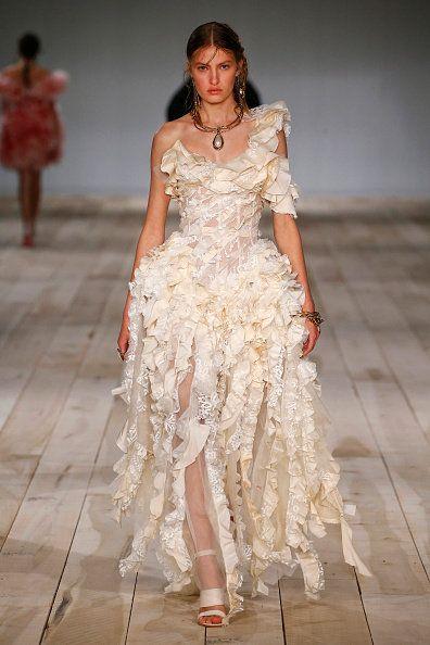 Fashion model, Fashion, Fashion show, Runway, Clothing, White, Dress, Haute couture, Fashion design, Gown,