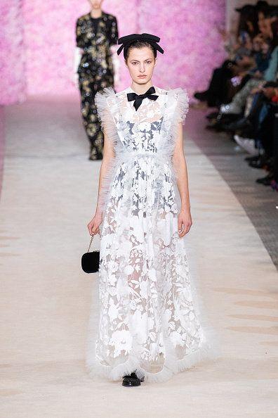 Fashion model, Fashion, Fashion show, Clothing, Haute couture, Dress, Runway, White, Shoulder, Gown,