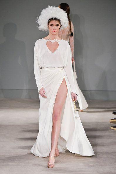 Fashion model, Fashion, Clothing, Dress, Fashion show, Runway, Gown, Haute couture, Shoulder, Wedding dress,