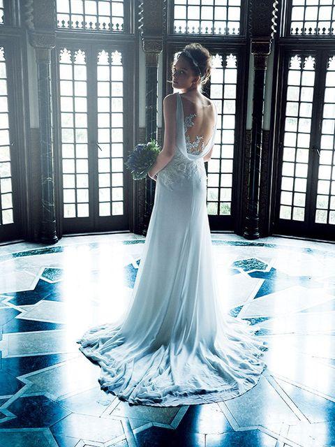 Dress, Floor, Shoulder, Flooring, Textile, Bridal clothing, Wedding dress, Gown, Formal wear, Style,