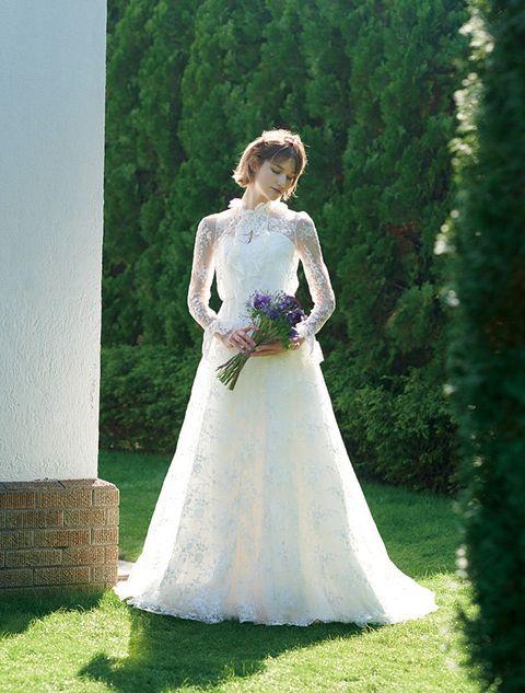Gown, Wedding dress, Bride, Dress, Clothing, Bridal clothing, Bridal party dress, Photograph, Bridal accessory, Formal wear,