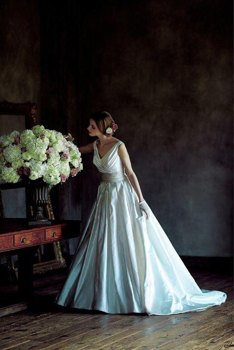 Gown, Bride, Wedding dress, Dress, Photograph, Clothing, Bridal clothing, Bouquet, Bridal party dress, Beauty,