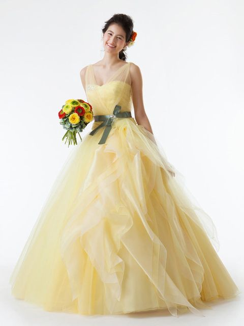 Gown, Dress, Wedding dress, Clothing, Bridal party dress, Fashion model, Bridal clothing, Shoulder, Yellow, Bride,