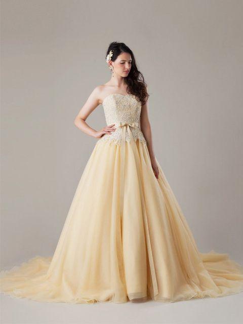 Gown, Fashion model, Clothing, Dress, Wedding dress, Bridal party dress, Shoulder, Bridal clothing, A-line, Bridal accessory,