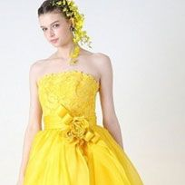 Dress, Clothing, Fashion model, Gown, Yellow, Cocktail dress, Shoulder, Bridal party dress, Strapless dress, Formal wear,
