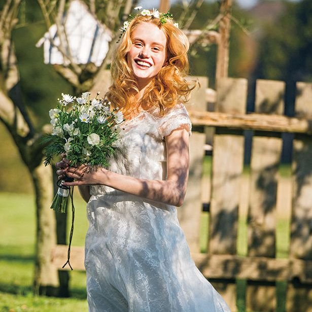 Clothing, Dress, Photograph, Petal, Happy, Bouquet, Formal wear, People in nature, Bride, Wedding dress,