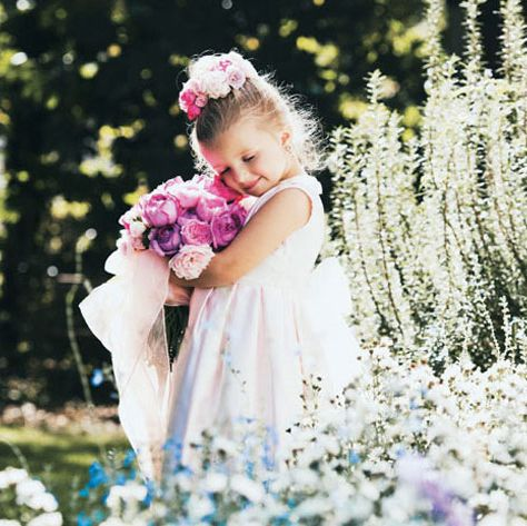 Petal, Flower, Dress, Happy, People in nature, Pink, Baby & toddler clothing, Hair accessory, Lavender, Headpiece,