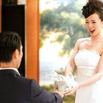Clothing, Hairstyle, Dress, Shoulder, Standing, Petal, Bridal clothing, Photograph, Outerwear, Happy,