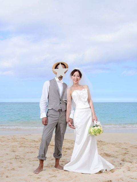 Clothing, Coastal and oceanic landforms, Trousers, Coat, People on beach, Photograph, Outerwear, Standing, Dress, Happy,