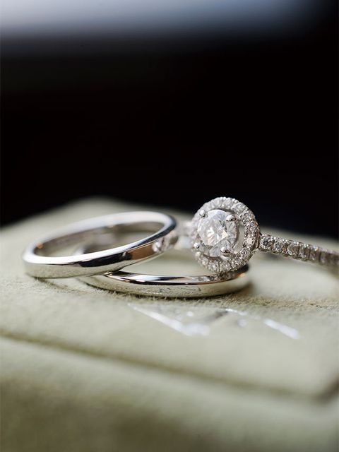 Wedding ring, Platinum, Ring, Body jewelry, Engagement ring, Pre-engagement ring, Jewellery, Fashion accessory, Wedding ceremony supply, Macro photography,