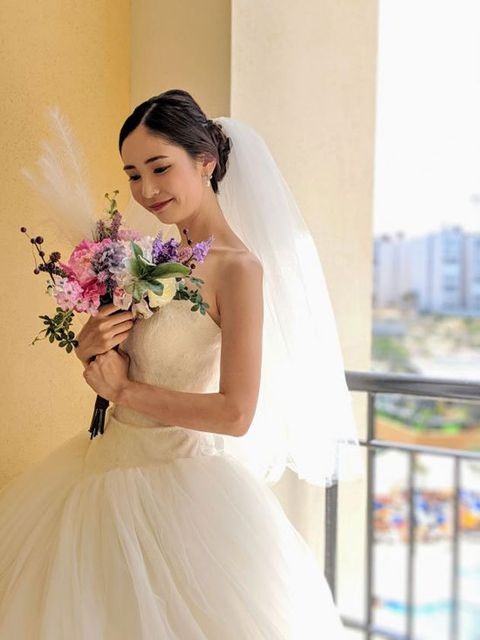Clothing, Petal, Dress, Bridal clothing, Shoulder, Photograph, Bridal veil, Happy, Bride, Wedding dress,
