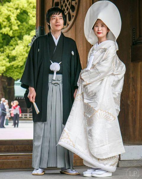 Costume, Costume accessory, Costume design, Street fashion, Mantle, Tradition, Sun hat, Cloak, Costume hat,