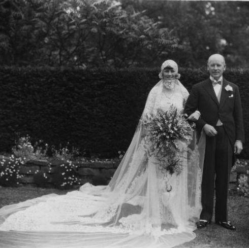 Clothing, Trousers, Bridal veil, Coat, Dress, Photograph, Petal, Bridal clothing, Veil, Suit,