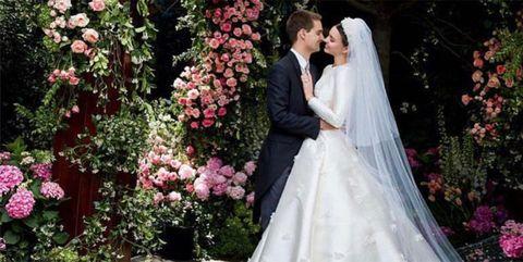 Clothing, Petal, Bridal veil, Bridal clothing, Veil, Dress, Photograph, Coat, Bride, Flower,
