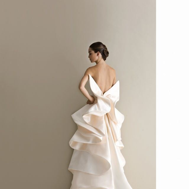 Gown, Dress, Wedding dress, Clothing, Fashion model, Bridal clothing, Shoulder, Bridal party dress, Bride, Bridal accessory,