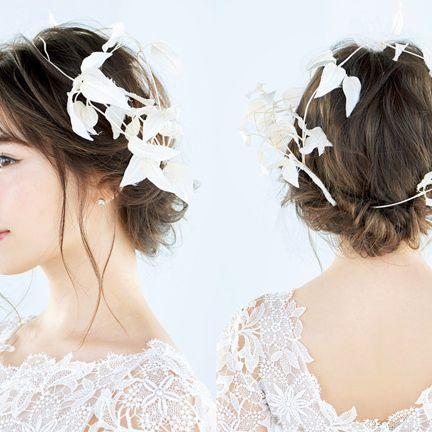 Hair, Headpiece, Clothing, Hair accessory, Hairstyle, Bridal accessory, Fashion accessory, Chignon, Ear, Headgear,