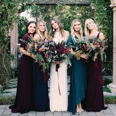 Dress, Bridal party dress, Bride, Shoulder, Floral design, Event, Floristry, Flower Arranging, Formal wear, Gown,