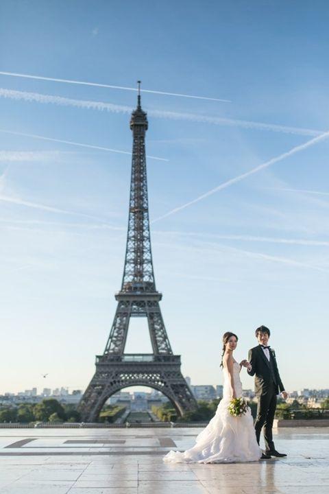 Photograph, Bride, Landmark, Sky, Wedding dress, Dress, Tower, Photography, Bridal clothing, Ceremony,