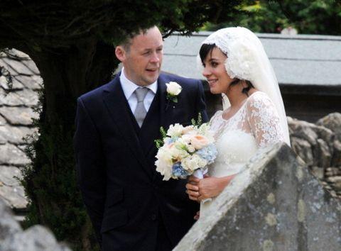 Bride, Wedding dress, Photograph, Veil, Gown, Bridal clothing, Ceremony, Bridal veil, Wedding, Facial expression,