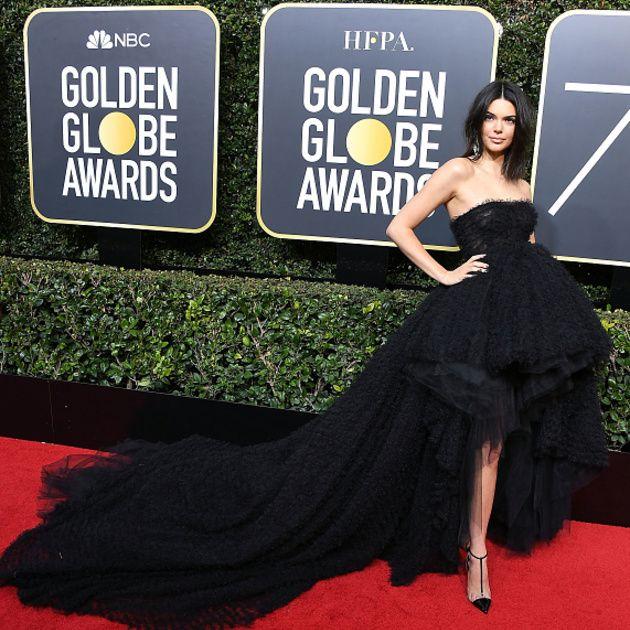 Dress, Red carpet, Clothing, Carpet, Strapless dress, Gown, Shoulder, Fashion, Flooring, Little black dress,